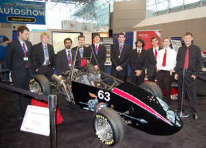 RFR team with car at auto show