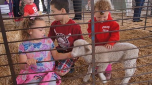 The children of Jessica DeMarco get acquainted with a new friend at Rutgers Day.