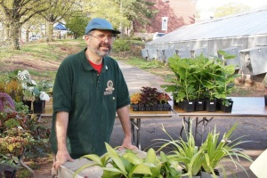 Volunteer and Cook alum Richard Porter carries plants available for sale.