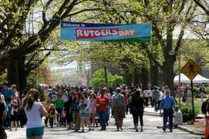 Students and visitors walking about on campus for Rutgers Day.
