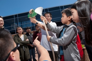 Randy Pugasa  and Chaoyu Cheng tests wind power during Rutgers Day