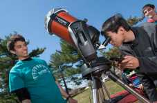 John Tamanas (SAS '16) waits as Peter Chu (SAS '15) checks out solar observations using telescope