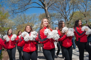 Cheerleaders march in Rutgers Day/Alumni Weekend parade on College Ave
