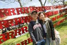 Patrick Choi and Jinny Cha stand in front of personalized R's hanging in R Garden on Rutgers Day